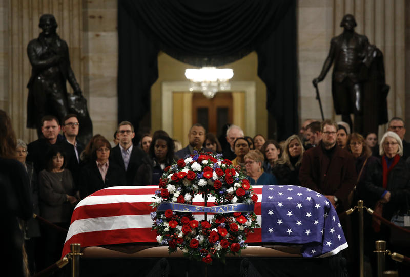The flag-draped casket of former President George H.W. Bush lies in state in the Capitol Rotunda in Washington, Tuesday, Dec. 4, 2018.