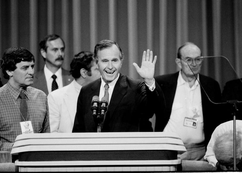 Vice President George Bush waves from the podium of the Dallas Convention Center in Dallas, Tex., as he checks it out prior to the start of the final session of the Republican National Convention, Aug. 23, 1984, in Dallas, Texas.