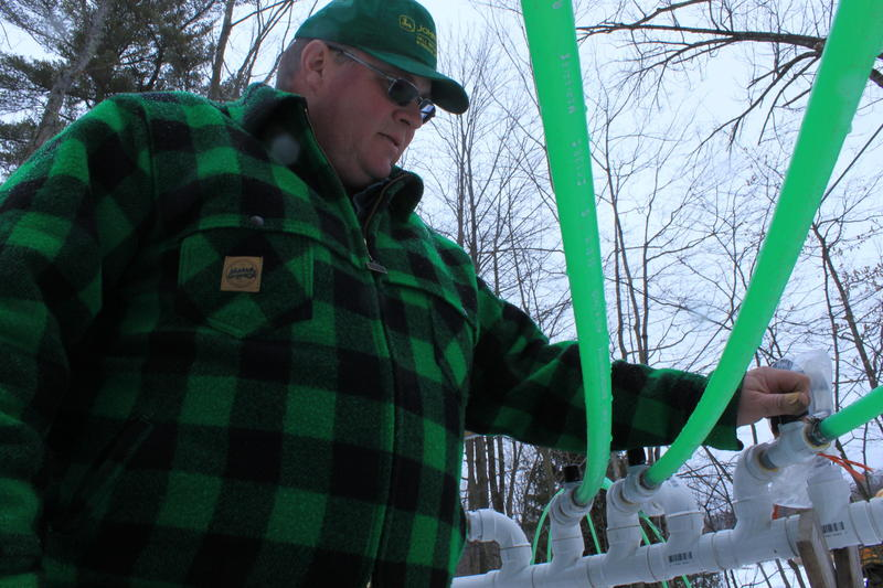 Lyle Merrifield checks his sap lines during the 2016 sugaring season.