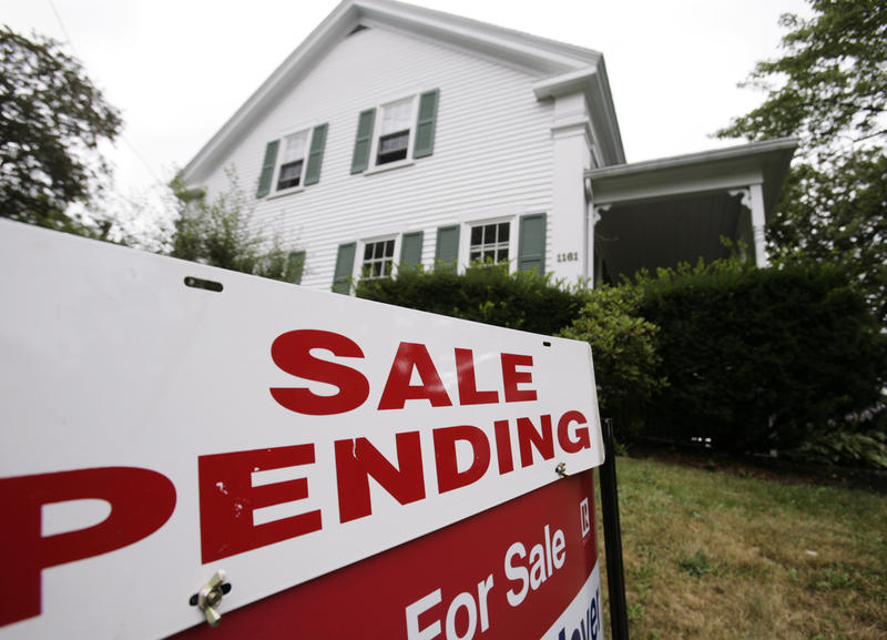 In this July 26, 2011 photo, a sale pending sign is posted outside a house in Bath, Maine.