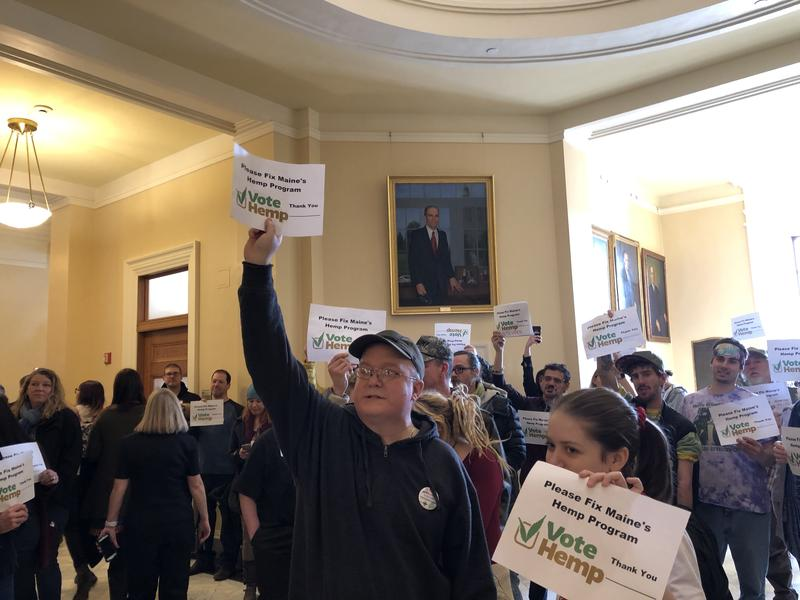 Hemp growers and supporters rally at the State House in Augusta on Tuesday.