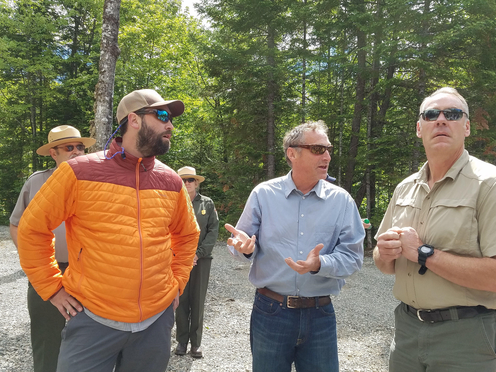 Left to right Lucas St. Clair local business owner Matt Polstein and U.S. Interior Secretary Ryan Zinke tour Maine's Katahdin Woods and Waters National Monument in June