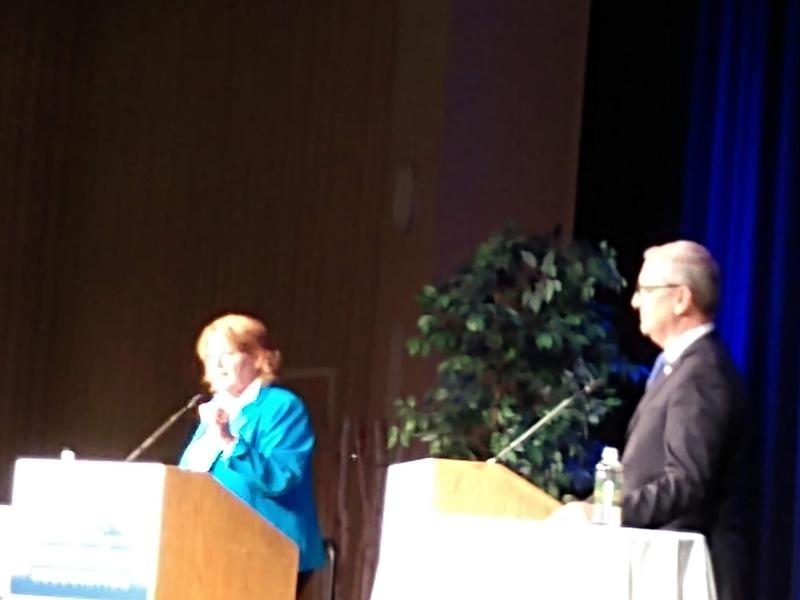 Heitkamp and Cramer on stage.
