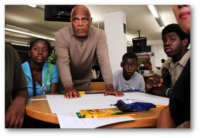 Bob Moses (center) started the Algebra Project in the 1980s, which attempts to raise the math literacy of low income students. Today, schools across the country utilize Moses' learning methods.
