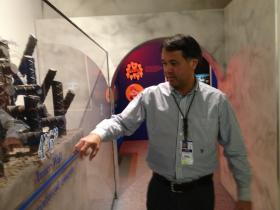 Alan Griffith of Seabrook Station at containment dome model.