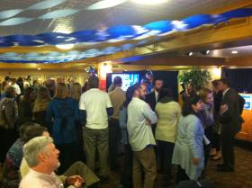Supporters at Annie Kuster's camp in Concord watch Hassan's victory speech on the monitors.