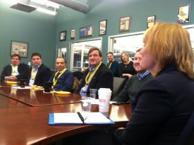 Gov.-elect Maggie Hassan meets with business and education leaders at Dyn in Manchester on Thursday.