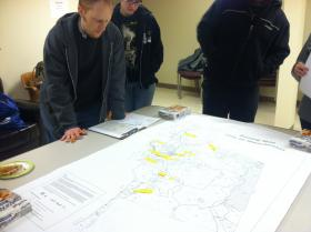 Mark Stokes studies a map of Manchester before heading out to count the homeless.