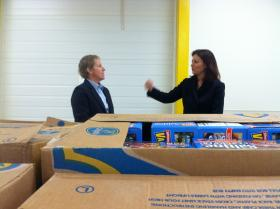 New Hampshire Food Bank director Mel Gosselin, left, speaks with U.S. Senator Kelly Ayotte, right, in Manchester on Wednesday.