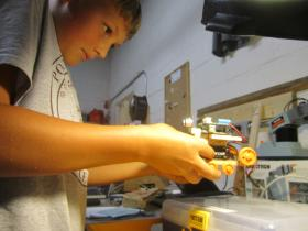 12-year old Sebastian Logue works on his 'tank robot thing' at the Port City Makerspace.