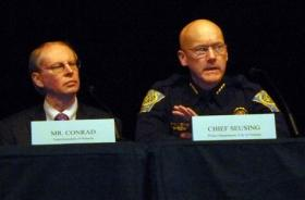 Nashua Superintendent Mark Conrad, left, and Police Chief John Seusing, right, address the audience at a public forum on school safety in Nashua on Thursday.