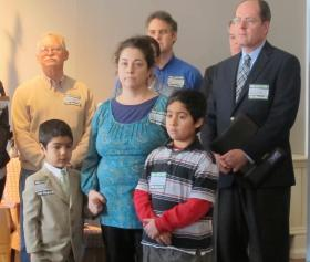 Dominique Vasquez-Vanasse stands with her two sons at a press conference. Later, she'll testify before the Ways and Means Committee in support of an education tax credit.