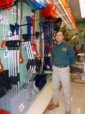 John Majewski of Aubuchon Hardware in Nashua stocks up on snow shovels.