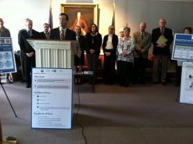 Attorney General Michael Delaney, surrounded by members of the Governor's Commission on Alcohol and Drug Abuse.