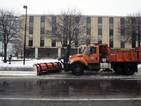 A plow makes its way down Elm street in Manchester