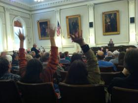 Northern Pass and Wind Farm opponent showed their approval for various speakers by waving their fingers, after having been told not to applaud.