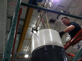 """John Bottaro working on """"a little R&D project"""" in SustainX's workshop. So far, the company employs 35 full-time employees – mostly engineers —  and another 15 contract employees."""