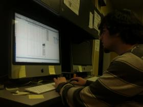 Ryan Glavey, executive editor of The Equinox, lays out the newspaper on a computer. The Equinox is the student-run newspaper at Keene State College.