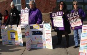 Demonstrators picket outside of Manchester Community College