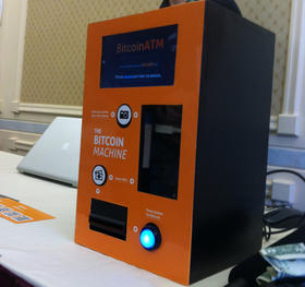Zach Harvey and his partners demonstrate their Bitcoin ATM at the Liberty Forum
