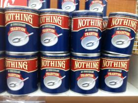 """Cans of """"Nothing"""" are designed to highlight hunger on grocery store shelves."""