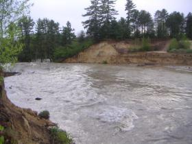 Taken soon after the avulsion, this photo captures the cross-section of the ridge that used to contain the river, but which was overrun in the Mother's Day flood