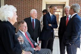 President Barack Obama talks with with former Presidents George H.W. Bush, Jimmy Carter, Bill Clinton, George W. Bush, and former First Lady Barbara Bush at the opening of the George W. Bush Presidential Library and Museum in Dallas, Tex., April 25, 2013. First Lady Michelle Obama talks with an unidentified person in the background. Official White House Photo by Pete Souza.