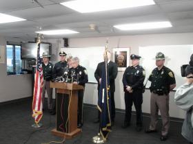 Bedford Police Chief John Bryfonski at podium.