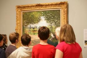 A Currier Museum docent leads a group of fifth-grade students from Green Acres Elementary School.