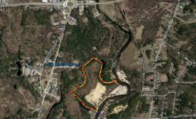 """The Suncook River jumped its banks in 2006 and carved itself a new course, an extremely rare event called an """"avulsion"""". The old course of the river is shown on with a dotted yellow line."""