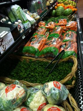 Nestled in among the standard produce in the grocery store, the curious coils of fiddleheads can't help but seem out of place