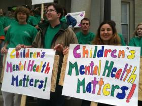 People rally outside the State House in Concord on Thursday to recognize Children's Mental Health Awareness day.