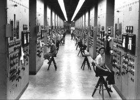 Young female cubicle operators monitor the activity of the calutrons, the heart of the uranium electromagnetic separation process at Y-12