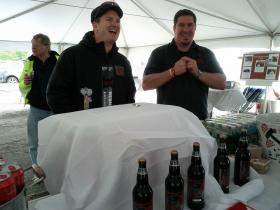 Brewmaster Billy Smith (left) serving up his lobster beer. Before the 3-hour event ended, they had expired the keg and had to pour from their 22 oz. bottles.