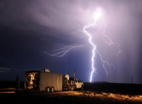 A cloud-to-ground lightning strike severs the sky near Los Lunas, New Mexico. Tim Samaras and his crew chased the slow-moving storm cell until they ran out of road, and now can only watch as it moves on. New Mexico's sparse road system makes lightning chasing difficult. Far easier to navigate are the tight grids of farm roads crisscrossing the Texas and Oklahoma Panhandles.