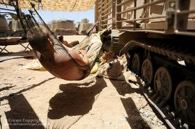 A soldier from 1st Battalion Welsh Guards (1WG) rests following intense fighting with Taliban insurgents in Helmand, Afghanistan during Operation Panchai Palang 2(Op Panthers Claw). Photographer:Cpl Dan Bardsley RLC