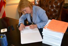 Gov. Maggie Hassan signs the 2014-15 budget into law.