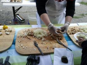 Volunteer chef Vicky Nawoichyk prepares pollock and silver hake at the kickoff event in Portsmouth.