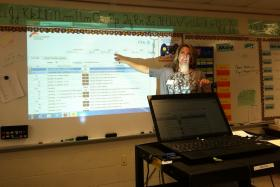 """Heather Driscoll demonstrates her curriculum mapping software to a class full of elementary teachers. Driscoll and many others think professional development and attention to teaching practice is what will make the roll-out of the Common Core a success. Otherwise she says the standards will be just another """"flash in the pan."""""""