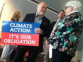 Rep. Rick Watrous and Sen. Martha Fuller Clark, both Democrats, attend an event to praise President Barack Obama's recently announced climate action plan.