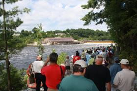 More than 300 excited spectators gathered to watch the breaching of Veazie Dam.