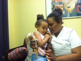 Elizabeth and Jazelle Raymond inside Child Health Services, a health clinic in Manchester.
