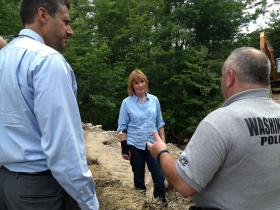 Governor Maggie Hassan tours flood damage in Washington, NH with Dept. of Transportation Commissioner Chris Clement and Washington Chief of Police Steven Marshall.