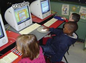 Kindergarteners busy at the computer at Hallsville Elementary School in Manchester.