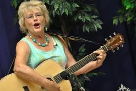Windham resident Barbara Danais, 70, performs a John Denver tune during the Ms. N.H. Senior America crowning ceremony held at the Windham Cable Access studio.