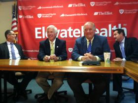 All smiles as executives introduce the ElevateHealth product at a press conference in Concord.