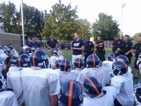 Ofc. Paul Rondeau gives a pep talk to the Manchester Bears.
