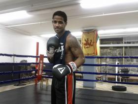 Joel Felix studies at Manchester Community College when he's not at the MPAL building training to be a pro boxer.
