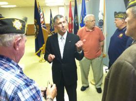 Gary Lambert speaks with veterans at the VFW in Hudson on Wednesday.