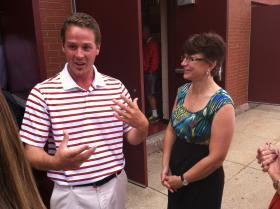 Pinkerton Academy teacher Joe Lee, left, talks with last year's New Hampshire Teacher of the Year Heidi Welch, right.